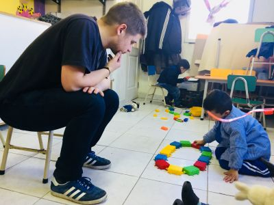 Volunteer Jack playing with kids